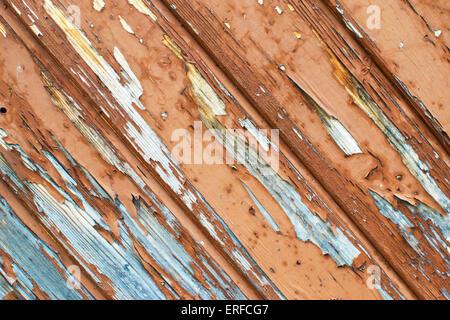 Brown Peeling paint on old wood door - Stock Photo