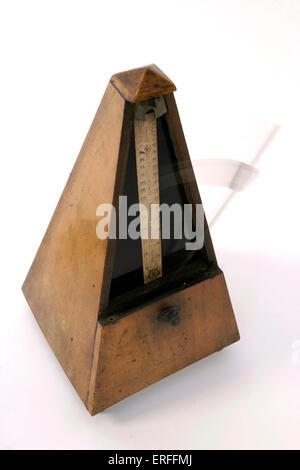 Wooden metronome - Stock Photo