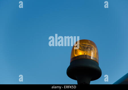 Single orange warning at blue sky - Stock Photo
