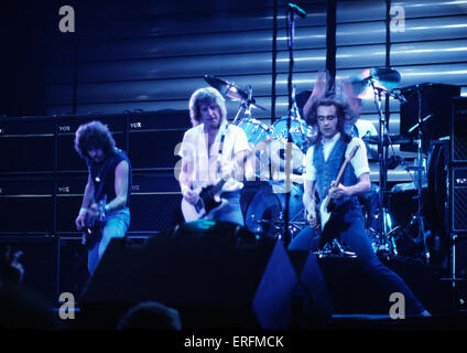 Status Quo - portrait of the English rock band performing at the Birmingham International Arena in 1982. Group was - Stock Photo