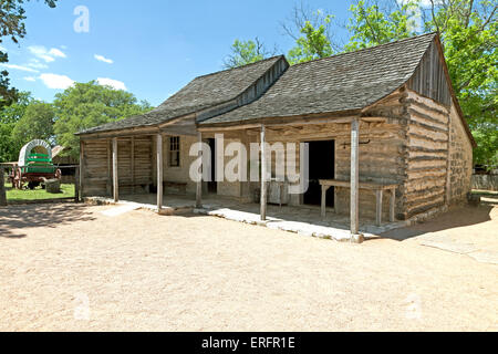 A log cabin, built in 1869, is preserved at Sauer-Beckman Living History Farm, LBJ State Park and Historic Site, - Stock Photo