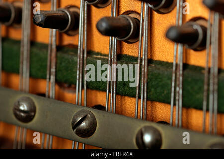Close-up detail of piano  - pegs or pins and strings from an upright piano - Stock Photo