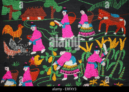 Traditional Embroidery of the Hmong Hill-tribe in Northern Thailand Depicting their Everyday Life Of Farming - Stock Photo