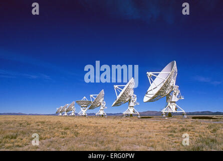 The giant radio telescopes of the Very Large Array, or VLA, on the Plains of San Agustin, between the towns of Magdalena - Stock Photo