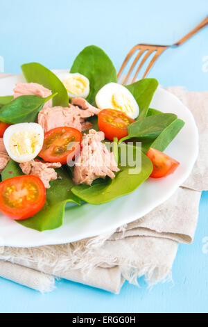 Fresh salad with spinach, tuna, tomatoes and quail eggs - Stock Photo