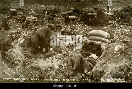World War 1: British soldiers sleeping in shell holes. British Offical War Photograph, published on postcard. Series - Stock Photo