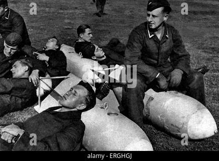 World War 2: German soldiers resting on bombs. Postcard published by Der Adler, illustrated magazine of the German - Stock Photo