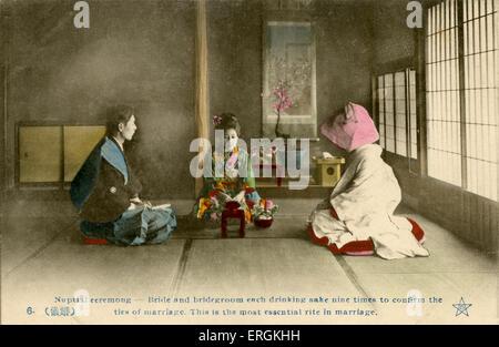 Japanese marriage ceremony in the late Meijiera (1868-1912). Caption reads: 'Nuptual ceremony - Bridge and bridegroom - Stock Photo