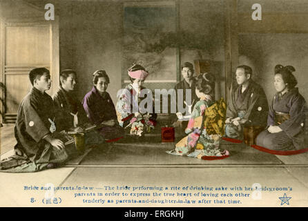 Japanese marriage ceremony in the late Meiji era (1868-1912). Caption reads: 'Bride and parents in law - the bride - Stock Photo