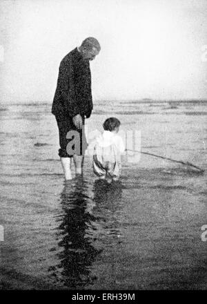 Sir Arthur Conan Doyle photographed on the Bournemouth coast with his youngest son, Adrian. Paddling in the sea. - Stock Photo