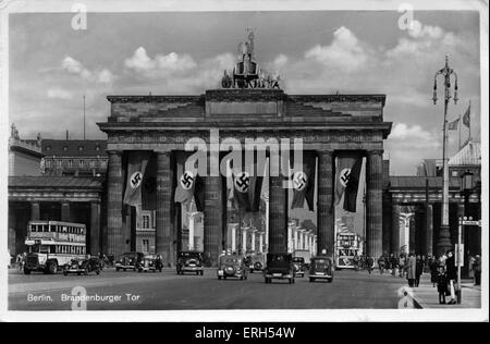 Berlin, Germany:The Brandenburg Gate / Brandenburger Tor. Nazi party flags cover the city gate. Postcard stamped - Stock Photo