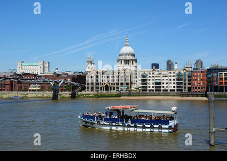 St Paul's Cathedral surrounded by modern buildings on the north bank of the River Thames, London - Stock Photo