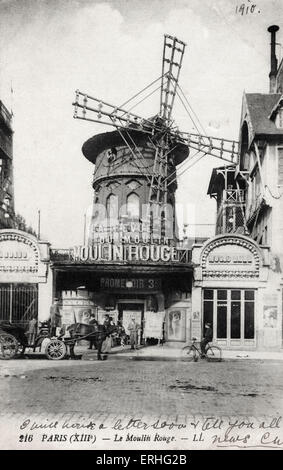 Paris scene.  13th arrondisement. Le Moulin Rouge (Red Windmill) famous for its cabaret shows. Horse and carriage - Stock Photo