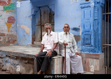 elderly man and typical blue facade in Jodhpur, Rajasthan, India, Asia