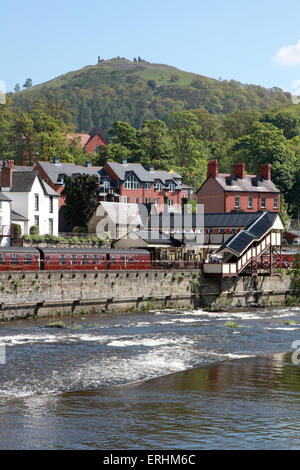 Looking across the river Dee to the station and the castle of Dinas Bran on the hilltop in Llangollen, north Wales - Stock Photo