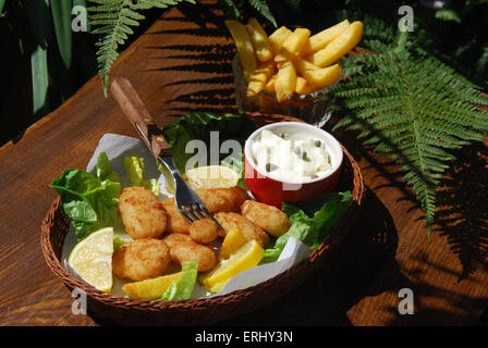 Scampi and chips in a basket with sauce Ta Ta - Stock Photo