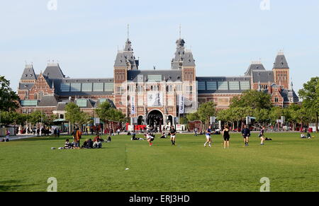Rijksmuseum building, Amsterdam, The Netherlands seen from the south side of spacious Museumplein square - Stock Photo