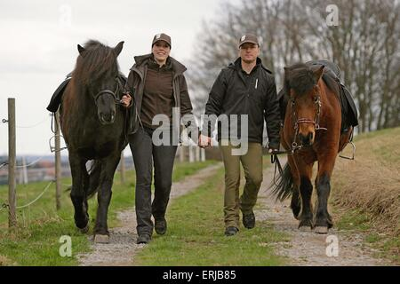 people and horses - Stock Photo