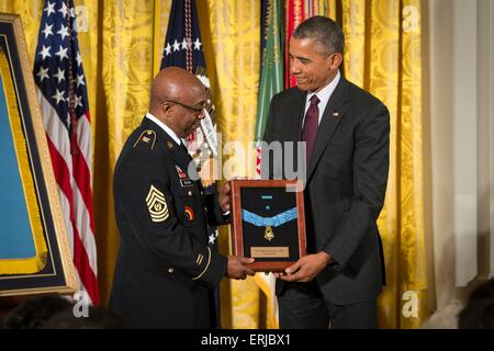 U.S. President Barack Obama awards the Medal of Honor to Command Sergeant Major Louis Wilson of the New York National - Stock Photo