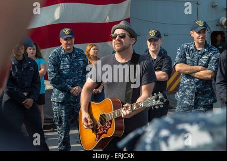 Two-time Grammy award-winner and founding member of the band Sugarland, singer Kristian Bush, performs for US sailors - Stock Photo