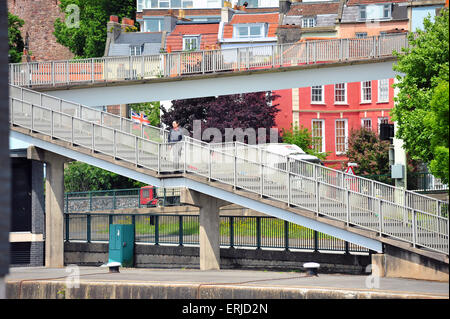 A man walks down a long ramp of steps after crossing the A4 road in Bristol on a pedestrian overpass. - Stock Photo