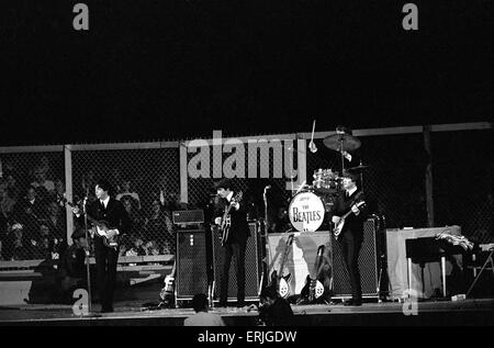 British pop group The Beatles performing on stage at the Cow Palace in San Francisco, California during their North - Stock Photo