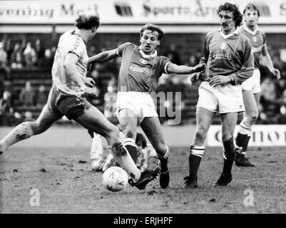 Birmingham City footballer Robert Hopkins in action challenged by Nowrich City players Greg Downs as Des Bremner - Stock Photo