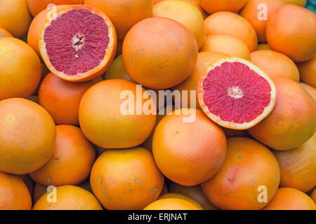 Ripe blood oranges for sale on a market - Stock Photo
