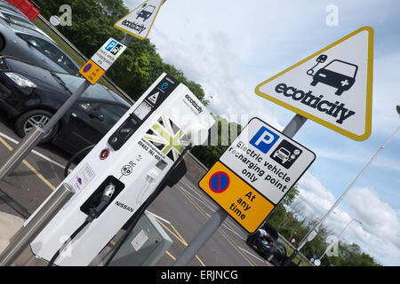 Electric vehicle recharging point provided by Ecotricity at a motorway service station on the M1 motorway UK - Stock Photo