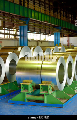 rolls of steel plate stored in warehouse - Stock Photo