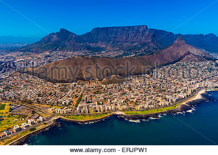 Aerial view of coastline of Cape Town with Signal Hill and Table Mountain in background, South Africa. - Stock Photo