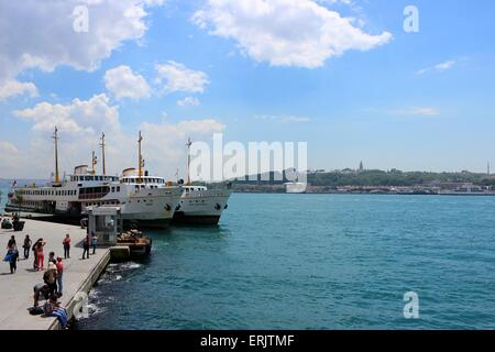 Ferryboats in Karakoy dock, Golden Horn. Topkapi Palace can be seen in the background. - Stock Photo