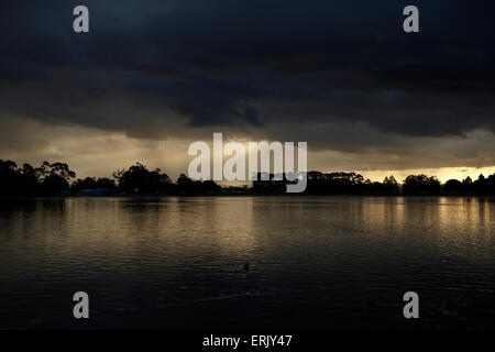 Approaching storm over Lake Rotoroa, Hamilton, Waikato, North Island, New Zealand - Stock Photo