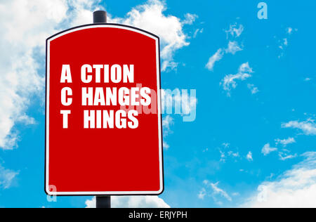 Action Changes Things  motivational quote written on red road sign isolated over clear blue sky background. - Stock Photo