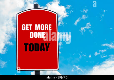 Get More Done Today motivational quote written on red road sign isolated over clear blue sky background. - Stock Photo