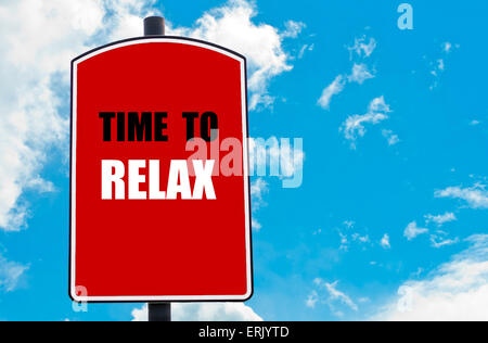 Time To Relax motivational quote written on red road sign isolated over clear blue sky background - Stock Photo