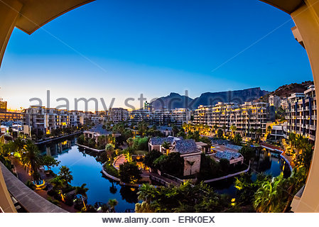 View from balcony at sunrise with apartment buildings and Table Mountain in background, Hotel One&Only Cape Town, - Stock Photo