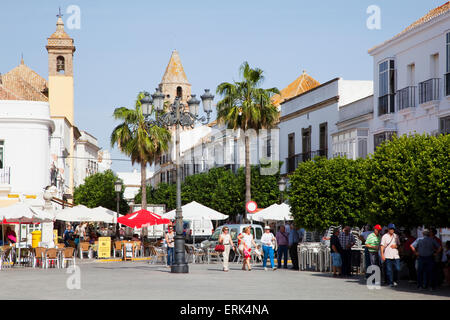 Pedestrians in a town square; Medina Sidonia, Andalusia, Spain - Stock Photo