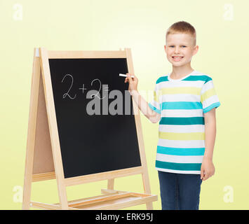 happy little boy with blackboard and chalk - Stock Photo