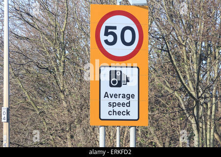 Average speed check sign 50 mph - Stock Photo