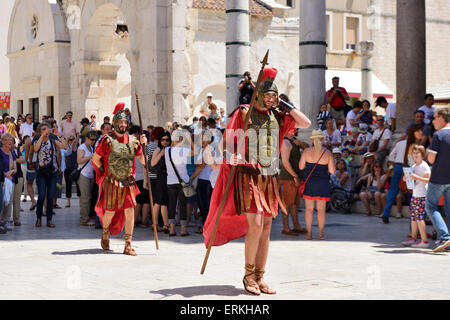 Roman soldiers in central square (peristyle) of Diocletian Palace in Split on Dalmatian Coast of Croatia - Stock Photo