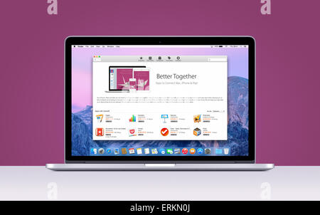 Directly front view of Apple MacBook Pro Retina with an open App Store on purple background. Varna, Bulgaria - November - Stock Photo