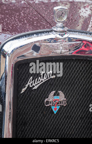 Front of Austin Seven classic old car with Austin 7 Dorset Car Club badge on grille and engine temperature gauge - Stock Photo