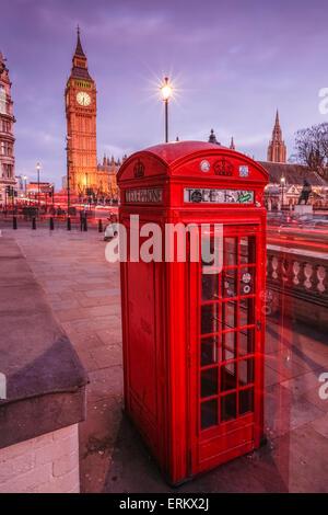 Typical English red telephone box near Big Ben, Westminster, London, England, United Kingdom, Europe - Stock Photo