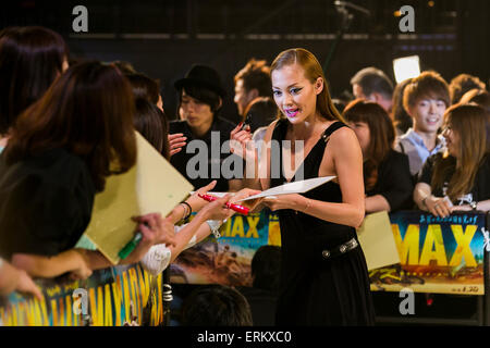 Anna Tsuchiya singer, actress and fashion model sings autographs for fans during the Japan premiere for the film - Stock Photo