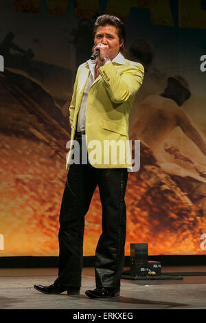 Actor Riki Takeuchi speaks during the Japan premiere for the film ''Mad Max: Fury Road'' in Tokyo Dome City Hall - Stock Photo