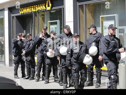 Munich, Germany. 04th June, 2015. Police officer secure a branch bank during a protest against the G7 Summit in - Stock Photo