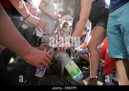 Munich, Germany. 04th June, 2015. Protestors fill their bottles with water during a protest against the G7 Summit - Stock Photo