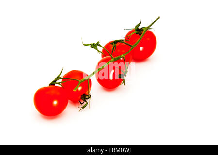 cherry tomatoes with stem vine fresh food healthy option organic produce red ripe tomato vegetable  isolated cutout - Stock Photo