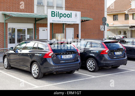 Sunfleet carpool parking lot with environmentally friendly Volvo cars in town center, Lerum, Sweden.  Model Release: - Stock Photo